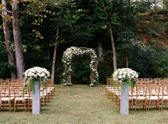 Wedding ceremony at Dara's Garden in Knoxville, TN. Flowers by Lisa Foster Floral Design.  Wedding flowers