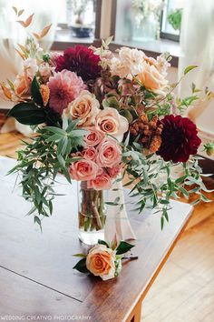Creativo Loft wedding // fall bouquet - beautiful cascading bouquet in coral, burgundy, peach, ivory - by Toni Lenzi at Simply Flowers Chicago