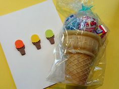 Cute party favor packaging--stick it in an ice cream cone and wrap it in a bag with a tag!