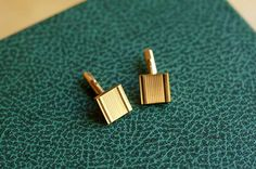 Square gold-plated vintage cufflinks with engine-turned design