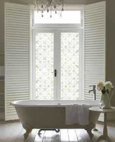 Lovely bathroom, like the frosted glass too