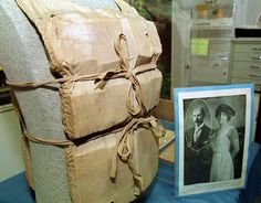 This is the actual life vest worn by Madeline Astor, wife of John Jacob Astor IV, is seen on display at the Titanic Museum in Springfield, Mass., April 3, 2001. Astor, who was 18 at the time, is shown with her husband, 48 at the time, in the photograph at right. She survived the sinking of the Titanic on April 12, 1912, aboard one of the lifeboats. (AP Photo/Nancy Palmieri)
