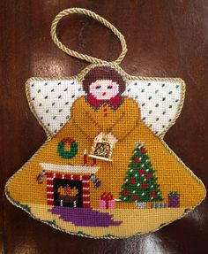 Great Painted Pony angel for the holidays. Lots of great themes on these. At posneedlepoint.com #needlepoint