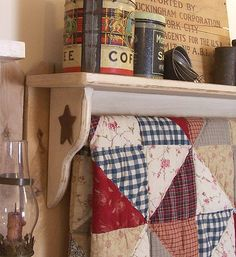 Very cozy and homey primitive quilt display