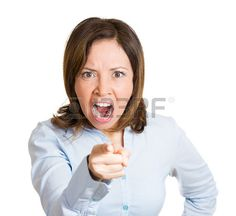 Closeup portrait young, yelling unhappy, serious woman pointing at someone as if to say you did something wrong, bad mistake, isolated white background. Negative emotion, facial expression feeling Stock Photo