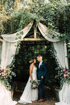 summer wedding arch ideas with fabric and eucalyptus garland