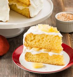 Piña Colada Cake-The tropical flavors of coconut, pineapple and rum combine to make a deliciously moist cake that brings to mind warm spring and summer sea breezes and swaying palm trees. This dessert is perfect for Mother's Day, wedding or baby showers, anniversaries or any special occasion.