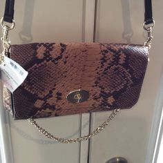 BRAND NEW WITH TAGS COACH SNAKESKIN RUBY CROSSBODY Excellence ! Beautiful bag. Strap is detachable easy to convert to clutch.   Still in box. Coach Bags Crossbody Bags