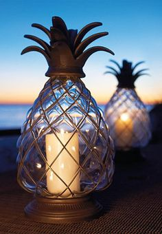 "LOVE these!!!  Pineapple Hurricane Lanterns @ Frontgate.com!  2 sizes: Large: 8-1/2"" dia. x 17""H ($69.50) or  Medium: 6-1/2"" dia. x 12-1/4""H ($99.50)"
