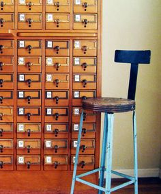 Card catalog with divided pulls for numbering and written descriptions. Multiple writing pull-out boards between sections as well.