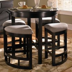 Find this Pin and more on Home Broyhill Mirren Pointe Round 5 Piece Counter Pub Table Set
