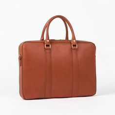 """Cognac leather briefcase. Made out of full-grain vegetable tanned leather. Fits 15""""inch laptop."""