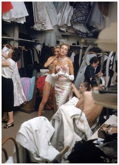 white gown and pearls backstage at Pierre Balmain, Paris, 1954 by Mark Shaw