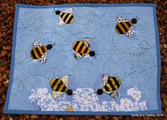 Quilts of a Feather: Flight of the Bumblebees mini quilt. I really like what's going on here.