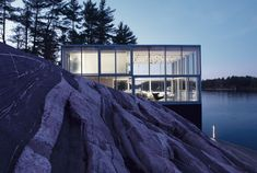 Built by gh3 in Ennismore, Canada with date 2007. Images by Larry Williams. A photographer's studio over a boathouse on Stony Lake is a re-imagination of the archetypal glass house in a landsca...