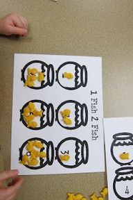 I think I'll make these and laminate them...then whenever we have Goldfish for a snack these will be our placemats.