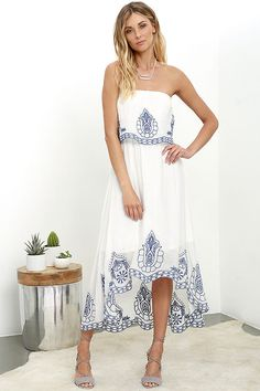 The Honored Tradition Ivory Strapless High-Low Dress will be held in high regard in no time! Blue embroidery decorates a fluttering flounce of woven fabric as it falls from a strapless, elasticized neckline. Midi skirt extends from an elastic waistline to a high-low hem with more embroidery!