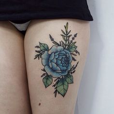 Blue rose thigh tattoo