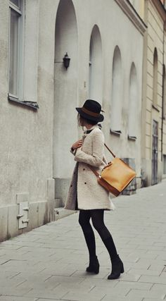 black wool hat with light Coat / Jacket over tights - Travel Photograph