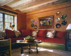 Wendy Lloyd Interior Design | Bethesda, MD  #familyroom #livingroomdesign #europeanstyle #orangeandred #frenchstyle #beamedceiling #exposedbeams #rusticstyle #rusticlivingroom