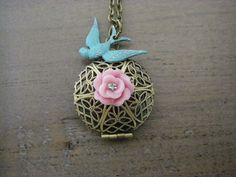 Gorgeous pairing of a verdigris patina bird that I hand painted and distressed and a pink rose. The rose is accented with a tiny crystal center.