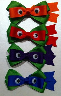 Set of four ninja turtle hair bows. Each set comes with 1 red, 1 blue, 1 orange and 1 purple. Each bow is about 4 inches wide and has an alligator clip
