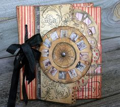 Vintage style Tim Holtz Picture Wheel on a stamped stripe background