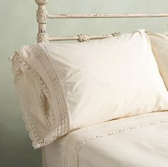 "Hand-crocheted inserts and edging lend heirloom presence to bedding of pristine cotton percale. Machine wash. Imported. 20""W x 26""L."