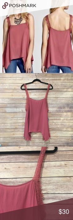 """Free People Dobby Dot & Lace Delicate Sides Cami NWT Free People Dobby Dot & Lace Delicate Cami in rose. Rayon. Semi sheer. Lace trim. Asymmetrical hem. Length from shoulder is about 26.5""""-31.5"""". Trapeze style. Armpit to armpit is 21"""" flat. Free People Tops Camisoles"""