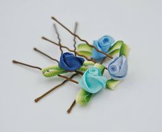 Check out this item in my Etsy shop https://www.etsy.com/listing/527829408/blue-rose-hair-pins-blue-flower-girl