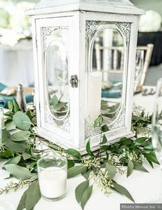 Wedding centerpiece ideas - greenery, white, lantern, table decor {Photo House Inc}