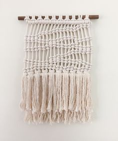 A slightly more masculine take on macrame.  As part of a series inspired by water, this wall hanging incorporates a vertical hitch knot to create the illusion of deep water waves.  Wooden dowel...