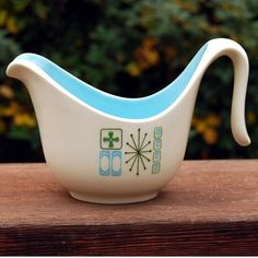 This creamer is an atomic mid-century modern design by Taylor, Smith & Taylor (which was founded in 1899 and closed in 1981). This is the Cathay pattern, which often has a mint green interior, but this is a beautiful robin's egg blue. This pattern was made from the late 1960s to early 1970s.  Might Also be Jamaican Bay Pattern - Marked TS