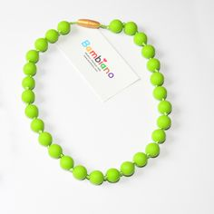 Bambiano Nicole Jr Necklace in Chartreuse. Bambiano Jr Necklaces are made of 100% Food grade silicone. BPA free, Lead free and nontoxic. Fashionable for trendy girls 3 years and above. Necklaces are colourful, washable and soft against the skin. Shop at www.bambiano.com