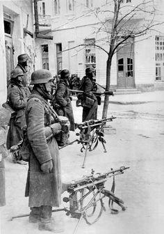 German patrol has deployed two machine guns on a street corner in Feodosiya, Crimea, 1942.