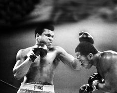 In what was called The Fight of the Century, Dan Farrell captured this action shot of Muhammad Ali taking a swing at Joe Frazier II at Madison Square Garden on Jan. 28, 1974.