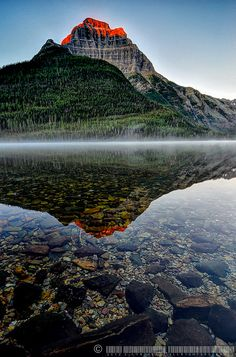 First light on Kinnerly Peak, Glacier National Park, Montana #travel #awesome places +++For more background images, visit http://www.hot-lyts.com/