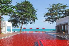 Near Chaweng Beach on Thailand's idyllic Koh Samui island, the Red Pool at the Library hotel beckons guests with its mesmerizing mosaic of yellow, orange, and red tiles. From $282/night; thelibrary.co.th