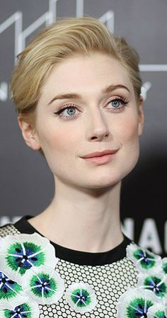 Elizabeth Debicki, Actress: The Man from U.N.C.L.E.. Debicki was born in Paris, to a Polish father and an Australian mother of Irish descent, who were both dancers. When she was five, the family moved to Melbourne, where she grew up with two younger siblings. She became interested in ballet at an early age and trained as a dancer until deciding to switch to theatre. A student at Huntingtower School in Melbourne's east, Debicki achieved two perfect ...