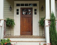 Front door - wood stained and creamy white. Like the wood, its classic and the windows around the door.