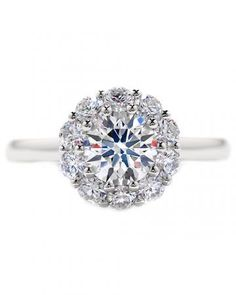 Glossary of Engagement and Wedding Ring Settings: Shared Prong - Adjacent diamonds share prongs.