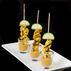 Chicken Satay served in a shot glass with peanut sauce is a great party appetizer!