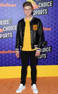 Nickelodeon's Knight Squad star adds a pop of color to his orange carpet look.