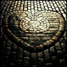 Heart of Midlothian  This marks the spot of the old tolbooth in Edinburgh. It's apparently good luck to spit on it when walking past so it took some skill to dodge the body fluids to get this shot...