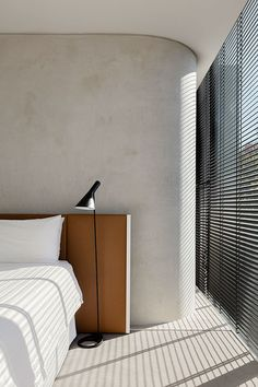 sunlight in window cement walls cement flooring minimalist apartment minimalist high rise apartment white sheets simple bedside lamp Interior Design Inspiration, Home Interior Design, Interior Architecture, Interior Decorating, Design Ideas, Decorating Tips, Studio Interior, Decorating Websites, Apartment Interior