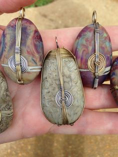 Glass Bead Rocks with wire wrapping by LIbby Leuchtman.
