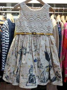 A woodland print runs round the hem of this toddler age dress with a crochet lace top from Next for fall 2013