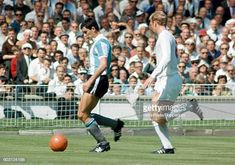 Argentina striker Luis Artime is shadowed by England captain Bobby Moore during the World Cup quarterfinal match between England and Argentina at. Bobby Moore, Fifa, 1966 World Cup Final, Stock Pictures, Stock Photos, British Football, Bbc Broadcast, Wembley Stadium, Champion