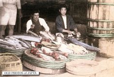 1890's. Japanese Fishmongers. Two young men are relaxing in a fish shop. Fish has always been an important part of the Japanese diet and was sold both at shops and by fish peddlers (furiuri) who walked around carrying fish in tubs that hung from a carrying pole on their shoulder.