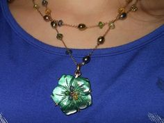 """Vintage Estate Gold Tone Double Strand Shades of Green Beaded Necklace with Green Etched """"Shell"""" Floral Pendant by cherylsvintagebling. Explore more products on http://cherylsvintagebling.etsy.com"""